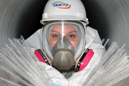 DUCTZ Franchise employee cleaning inside a duct